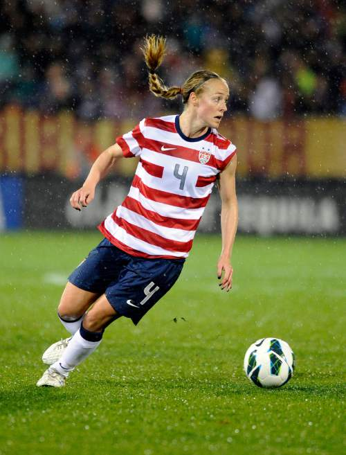 FILE - In this Oct. 12, 2012, file photo, United States' Becky Sauerbrunn dribbles the ball during an international friendly soccer match against Germany in East Hartford, Conn.Midfielder Carli Lloyd and Sauerbrunn have been chosen captains of the U.S. Women's National Team.  (AP Photo/Fred Beckham, File)