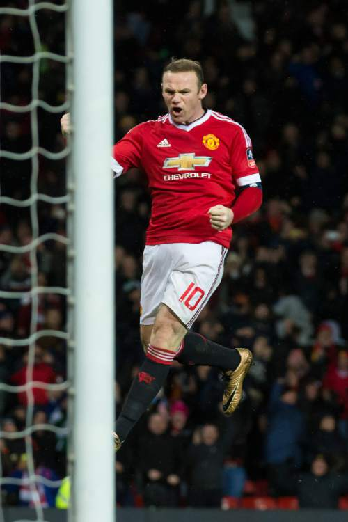 Manchester United's Wayne Rooney celebrates after scoring during the English FA Cup third round soccer match between Manchester United and Sheffield United at Old Trafford Stadium, Manchester, England, Saturday Jan. 9, 2016. (AP Photo/Jon Super)
