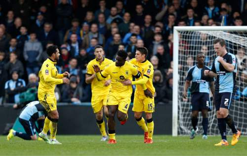 Aston Villa's Micah Richards, center, celebrates scoring his side's first goal of the game during their FA Cup, third round soccer match against Wycombe Wanderers at Adams Park, High Wycombe, England, Saturday, Jan. 9, 2016. (Paul Harding/PA via AP)      UNITED KINGDOM OUT     -    NO SALES     -     NO ARCHIVES