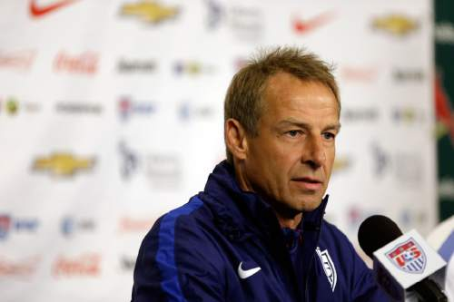FILE - This Nov. 12, 2015 file photo shows U.S. men's national soccer team coach Jurgen Klinsmann taking part in a news conference in St. Louis. Clint Dempsey, Kyle Beckerman, Chris Wondolowski, Graham Zusi and Brad Evans were among the veteran players left off Klinsmann's training camp roster ahead of exhibition games against Iceland and Canada. Eleven players on the youth-filled roster announced Wednesday, Jan. 6, 2015 are eligible to play for the American under-23 team, which faces Colombia in a two-leg playoff in March for a berth in this year's Olympics. (AP Photo/Jeff Roberson, file)