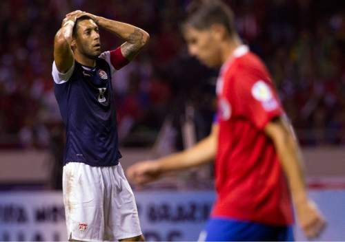 FILE - This Sept. 6, 2013 file photo shows United States' Clint Dempsey pausing after missing a chance to score against Costa Rica at a 2014 World Cup qualifier soccer match in San Jose, Costa Rica. Dempsey, Kyle Beckerman, Chris Wondolowski, Graham Zusi and Brad Evans were among the veteran players left off Klinsmann's training camp roster ahead of exhibition games against Iceland and Canada. Eleven players on the youth-filled roster announced Wednesday, Jan. 6, 2015 are eligible to play for the American under-23 team, which faces Colombia in a two-leg playoff in March for a berth in this year's Olympics. (AP Photo/Moises Castillo, file)