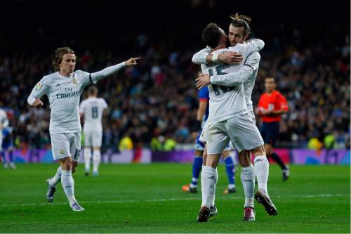 Real Madrid's Gareth Bale, right, celebrates with teammate Daniel Carvajal, second right, after scoring their side's second goal against Deportivo Coruna during a Spanish La Liga soccer match between Real Madrid and Deportivo Coruna at the Santiago Bernabeu stadium in Madrid, Saturday, Jan. 9, 2016. (AP Photo/Francisco Seco)