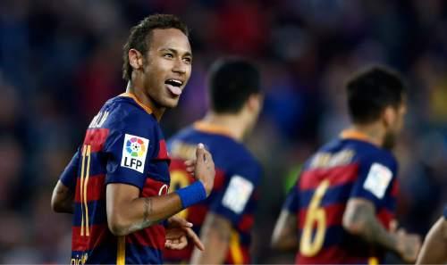 FC Barcelona's Neymar celebrates after scoring against Granada during a Spanish La Liga soccer match at the Camp Nou stadium in Barcelona, Spain, Saturday, Jan. 9, 2016. (AP Photo/Manu Fernandez)