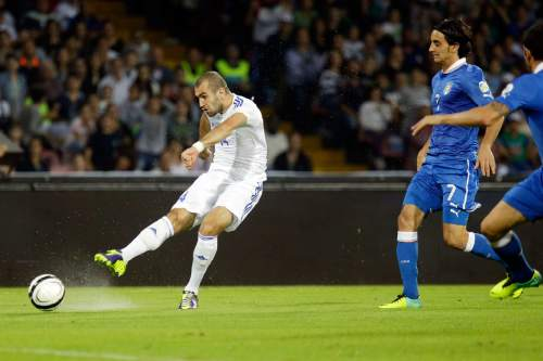 Armenia's Yura Movsisyan, left, scores during a 2014 World Cup, Group B, qualification match between Italy and Armenia in Naples, Italy, Tuesday, Oct. 15, 2013. (AP Photo/Gregorio Borgia)