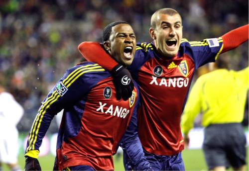 Real Salt Lake's Robbie Findley, left, is grabbed by teammate Yura Movsisyan after Findley scored against the Los Angeles Galaxy in the MLS Cup soccer match Sunday, Nov. 22, 2009, in Seattle. Real Salt Lake won the championship on a penalty kick shootout. (AP Photo/Elaine Thompson)