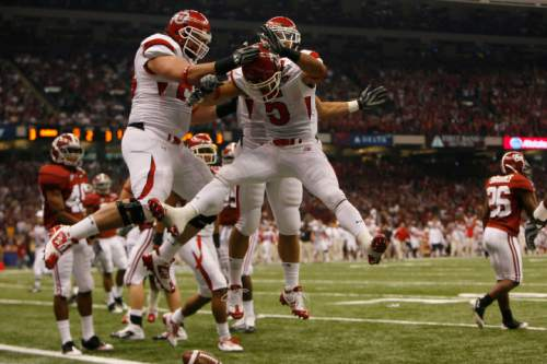Utah wide receiver Brent Casteel (5) celebrates with his teammates after scoring the first touchdown of the game as the Utes face Alabama in the 75th Anniversary Sugar Bowl in New Orleans, Louisiana, Friday, January 2, 2008.  Chris Detrick/The Salt Lake Tribune