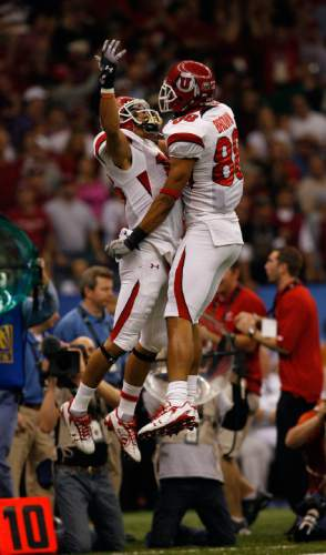 Utah wide receiver David Reed (16)  and Utah wide receiver Freddie Brown (88)  celebrate a big play as the Utes face Alabama in the 75th Anniversary Sugar Bowl in New Orleans, Louisiana, Friday, January 2, 2008.  Chris Detrick/The Salt Lake Tribune