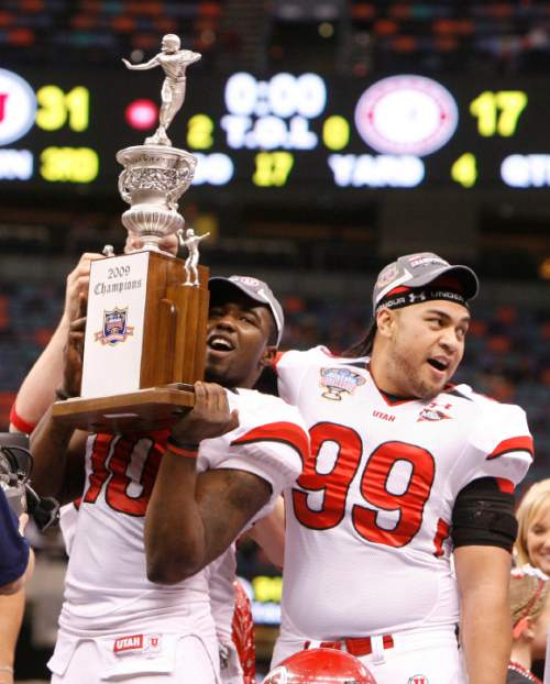 Utah linebacker Stevenson Sylvester (10) and Utah tight end Neli A'asa (89) celebrate with the trophy after the Utes defeated Alabama in the 75th annual Sugar Bowl in New Orleans, Friday, January 2, 2009.  Scott Sommerdorf/The Salt Lake Tribune