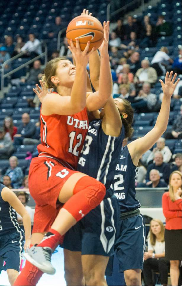 Rick Egan  |  The Salt Lake Tribune  Utah Utes forward Emily Potter (12) takes the ball up for a shot, as Brigham Young  forward Jasmine Moody (33) defends for the Cougars, in basketball action, BYU vs. The University of Utah,  in the Marriott Center, Saturday, December 12, 2015.