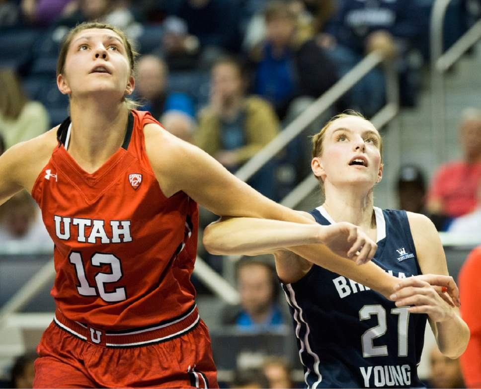 Rick Egan  |  The Salt Lake Tribune  Utah Utes forward Emily Potter (12) and Brigham Young Cougars guard Lexi Eaton Rydalch (21) battle for position, in basketball action, BYU vs. Utah, in the Marriott Center, Saturday, December 12, 2015.