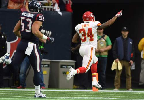 Kansas City Chiefs running back Knile Davis (34) runs for a touchdown as Houston Texans inside linebacker Max Bullough (53) chases him during the first half of an NFL wild-card football game Saturday, Jan. 9, 2016, in Houston. (AP Photo/Eric Christian Smith)