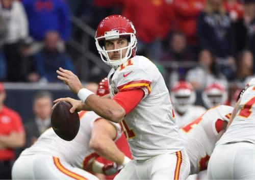 Kansas City Chiefs quarterback Alex Smith (11) looks to throw against the Houston Texans during the first half of an NFL wild-card football game Saturday, Jan. 9, 2016, in Houston. (AP Photo/Eric Christian Smith)