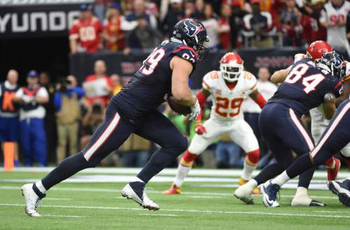 Houston Texans defensive end J.J. Watt (99) carries the ball on offense against the Kansas City Chiefs during the first half of an NFL wild-card playoff football game Saturday, Jan. 9, 2016, in Houston. (AP Photo/Eric Christian Smith)