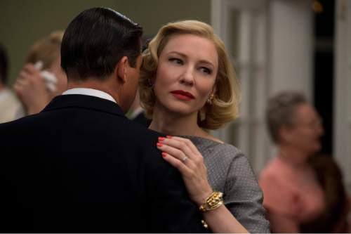 "This photo provided by The Weinstein Company shows, Kyle Chandler, left, as Harge Aird, and Cate Blanchett as Carol Aird in a scene from the film, ""Carol.""  (Wilson Webb/The Weinstein Company via AP)"