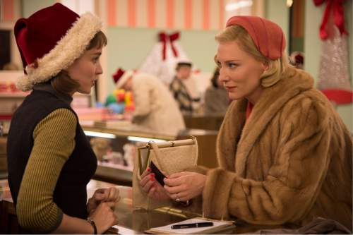 "This photo provided by The Weinstein Company shows, Rooney Mara, left, as Therese Belivet, and Cate Blanchett, as Carol Aird, in a scene from the film, ""Carol.""  (Wilson Webb/The Weinstein Company via AP)"