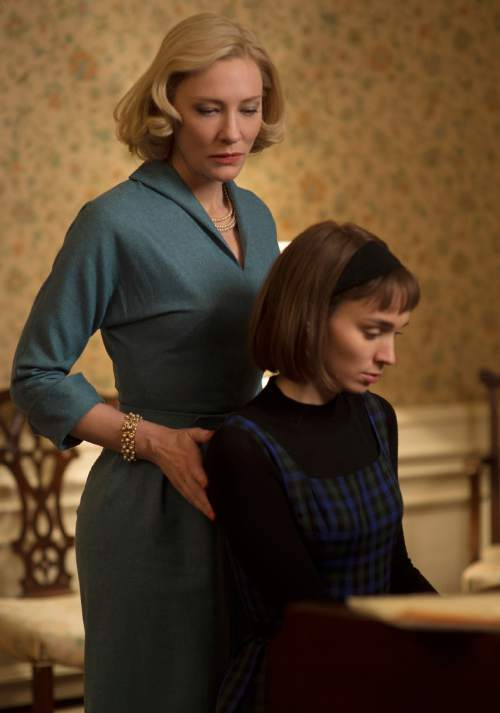 "This photo provided by The Weinstein Company shows Cate Blanchett, left, and Rooney Mara in a scene from the film, ""Carol."" The film was nominated for a Golden Globe award for best motion picture drama on Thursday, Dec. 10, 2015. Mara and Blanchett were also each nominated for best actress in a drama film. The 73rd Annual Golden Globes will be held on Jan. 10, 2016.  (Wilson Webb/The Weinstein Company via AP)"