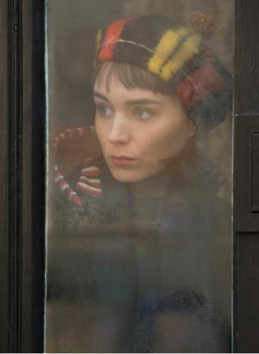 "This photo provided by The Weinstein Company shows, Rooney Mara, as Therese Belivet, in a scene from the film, ""Carol.""  The 73rd annual Golden Globe nominations in film and television categories will be announced Thursday morning, Dec. 10, 2015, in Beverly Hills, Calif.  (Wilson Webb/The Weinstein Company via AP)"