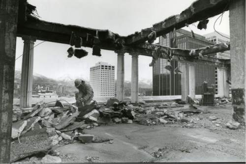file photo  |  The Salt lake Tribune  Construction crews demolish the roof of the Hotel Utah in 1991.