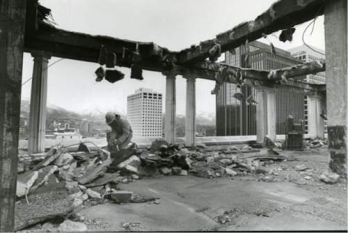 file photo  |  The Salt lake Tribune  Construction crews demolish the roof of the Hotel Utah in 1991.