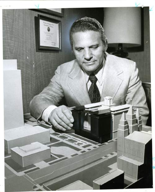 "Tribune file photo  The caption on the back of this 1972 photo reads, ""Henry N. (Hank) Aloia, managing director of Hotel Utah, shows with dark section of hotel model where new addition will be constructed on hotel's north side."""