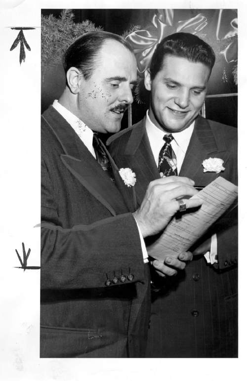 Tribune file photo  Arnold Hauslander poses for a photo with Hotel Utah's the head of catering at Hotel Utah, Henry Aloia in December 1948.