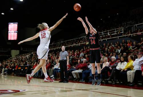 Utah guard Paige Crozon (14) shoots over Stanford guard Brittany McPhee (12) during the first half of an NCAA college basketball game Friday, Jan. 8, 2016, in Stanford, Calif.  (AP Photo/Marcio Jose Sanchez)