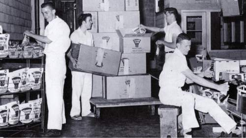 Students from Davis High School help in the Clover Club shipping department. Courtesy  |  Heritage Museum of Layton