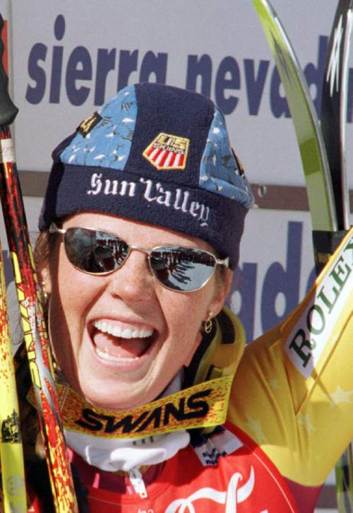 FILE - In this Feb. 18, 1998,  file photo, Picabo Street celebrates on the podium after winning the womens downhill at the World Alpine Ski Championships in Sierra Nevada, Spain. Authorities say Olympic gold medalist skier Picabo Street has been charged with assault and domestic violence stemming from a December altercation with a relative in Utah. Summit County Sheriff Sgt. Ron Bridge said Wednesday, Jan. 13, 2016,  that Street is accused of assaulting a family member but didn't give further details.(AP Photo/Michael Probst, File)