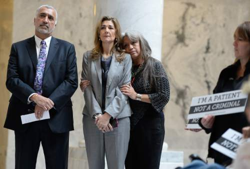Francisco Kjolseth | The Salt Lake Tribune District Attorney Sim Gill, left, holds a press conference at the State Capitol to announce a new patient initiative supporting medical cannabis. Christine Stenquist, center who suffers extreme pain from a cancer diagnosis is supported by Juanita Ramos-Corum prior to relaying her experience. Medical cannabis patients, each representing a different condition covered under Senator Madsen's bill, openly admit having violated Utah's marijuana laws out of medical necessity. District Attorney Sim Gill is advocating in support of changing policy to ensure that patients are not treated as criminals.