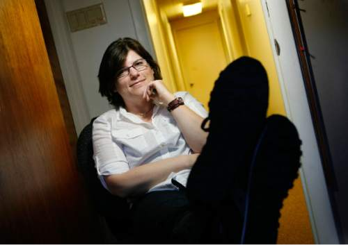 |  Tribune file photo  Author Sara Zarr says she often just puts her feet up on the sofa in her small office when she waits for inspiration to write.