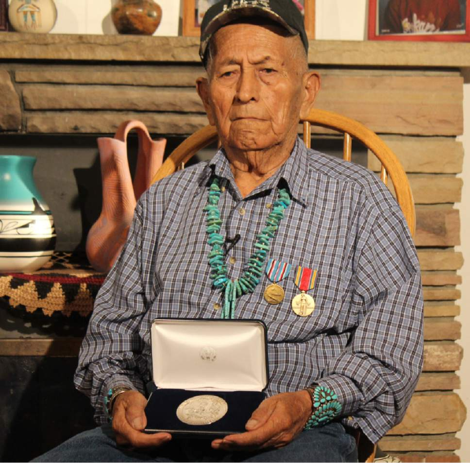 |  Courtesy Joel Frank  Ernest Yazhe poses with the medals he earned in World War II in this undated photo. Yazhe, who died Jan. 12, 2016, served in the U.S. Marine Corps as part of the famed Navajo Code Talkers.