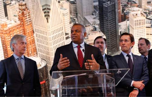 FILE - In this Thursday, Jan. 14, 2016, file photo, U.S. Transportation Secretary Anthony Foxx, second from left, speaks as auto executives listen at the North American International Auto Show in Detroit. Foxx announced Friday, Jan. 15, 2016, that the government and the auto industry have struck a peace treaty of sorts by agreeing to cooperate on safety issues in the future. (AP Photo/Paul Sancya)