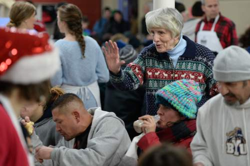 Francisco Kjolseth | The Salt Lake Tribune Homeless advocate Pamela Atkinson welcomes people as she and other community leaders served their annual Christmas dinner to more than 800 homeless Utahns Friday at St. Vincent de Paul Dining Hall in downtown Salt Lake City.