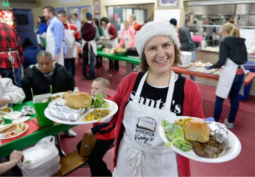 Francisco Kjolseth | The Salt Lake Tribune Claudia Pohl of Hamburg, Germany who was in town visiting friends, lends a helping hand for the annual Christmas dinner to more than 800 homeless Utahns Friday at St. Vincent de Paul Dining Hall in downtown Salt Lake City.