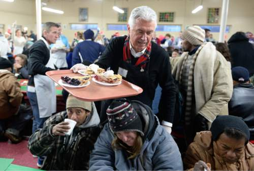 Francisco Kjolseth | The Salt Lake Tribune Dieter F. Uchtdorf, second counselor in the First Presidency of The Church of Jesus Christ of Latter-day Saints, serves up pie as volunteers and other community leaders serve the annual Christmas dinner to more than 800 homeless Utahns Friday at St. Vincent de Paul Dining Hall in downtown Salt Lake City.