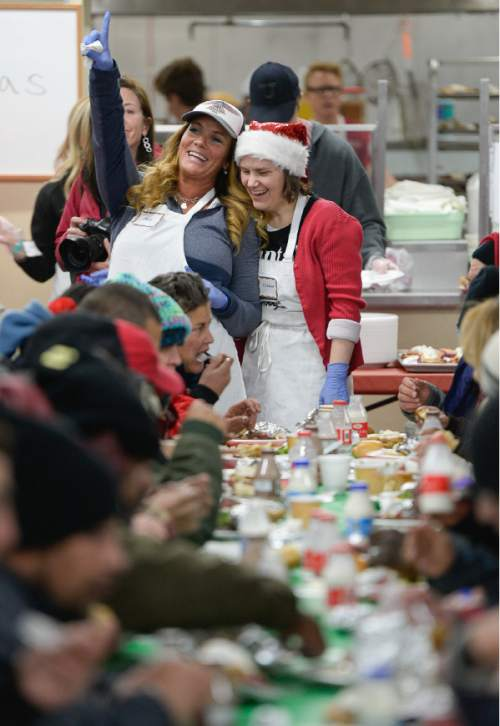 Francisco Kjolseth | The Salt Lake Tribune Julie Edwards, left, flags down an available seat as she is joined by Claudia Pohl, as volunteers and community leaders served their annual Christmas dinner to more than 800 homeless Utahns Friday at St. Vincent de Paul Dining Hall in downtown Salt Lake City.