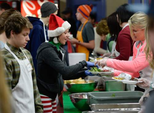 Francisco Kjolseth | The Salt Lake Tribune Buffy Parker, center left, gets another plate to serve as multiple volunteers and community leaders serve the annual Christmas dinner to more than 800 homeless Utahns Friday at St. Vincent de Paul Dining Hall in downtown Salt Lake City.