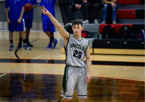 Scott Sommerdorf   |  The Salt Lake Tribune After the game ended, Copper Hills' G Preston Sanchez points to the scoreboard and shoots a look to the American Fork fans. Copper Hills defeated American Fork 64-61 in the Elite 8 semi-finals, Friday, December 11, 2015.