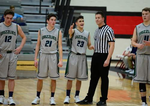 Scott Sommerdorf   |  The Salt Lake Tribune Copper Hills G Preston Sanchez  pleads his case with a  referee after being called for a foul during first half play as Copper Hills defeated American Fork 64-61 in the Elite 8 semi-finals, Friday, December 11, 2015.