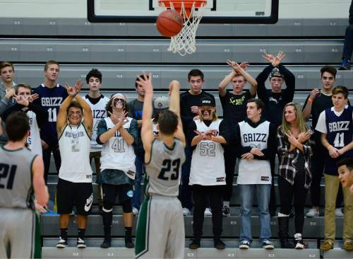 Scott Sommerdorf   |  The Salt Lake Tribune The Copper Hills student section gives support as Copper Hills G Preston Sanchez shoots free throws. Copper Hills defeated American Fork 64-61 in the Elite 8 semi-finals, Friday, December 11, 2015.