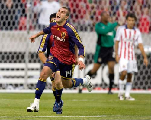 Real Salt Lake forward Yura Movsisyan (14) celebrates his goal against Chivas USA during the second half of the MLS playoff soccer game Saturday, Nov. 1, 2008, in Sandy, Utah. RSL defeated Chivas USA 1-0. (AP Photo/Douglas C. Pizac)