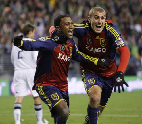 Real Salt Lake's Robbie Findley, left, and Yura Movsisyan celebrate the goal that tied the game 1-1 in the second half during the MLS Cup championship soccer game Sunday, Nov. 22, 2009, in Seattle. (AP Photo/Elaine Thompson)