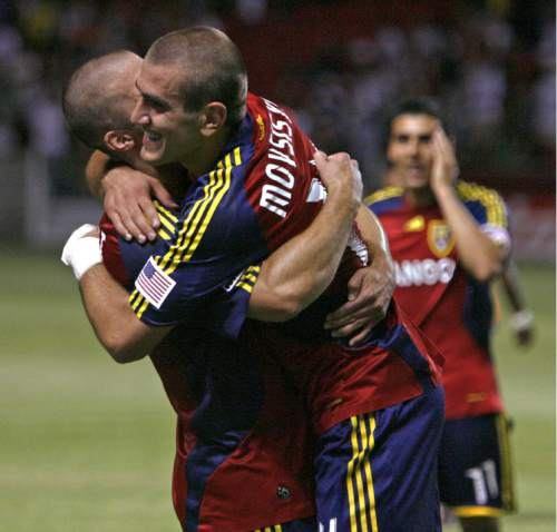 Real Salt Lake's Yura Movsisyan, right, celebrates with Chris Wingert after making two goals against FC Dallas at Rio Tinto Stadium on Friday, July 24, 2009. (AP photo/Stephen Holt - Salt Lake Tribune) -UTSAL, Deseret News Out, Local TV Out, Mags Out