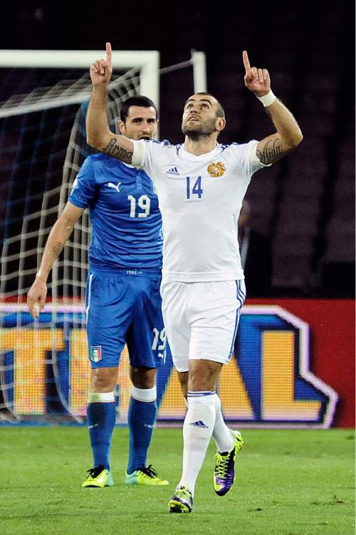 Armenia's Yura Movsisyan celebrates after scoring during a World Cup, Group B, qualification match between Italy and Armenia in Naples, Italy, Tuesday, Oct. 15, 2013. (AP Photo/Salvatore Laporta)