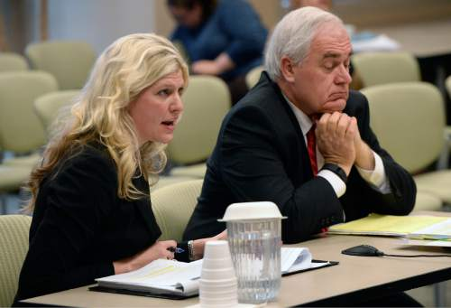 Al Hartmann  |  The Salt Lake Tribune Julia Kyte, lawyer for San Juan Commissioner Phil Lyman, left and Blaine Ferguson with the Utah Attorney General's office speak before the Utah State Records Committee, a non-judicial panel that hears appeals on public records Thursday Dec. 10 in Salt Lake City.  The Utah attorney general's office has asked for an unprecedented closed-door hearing and deliberations on a records dispute with The Salt Lake Tribune. At issue are records from the closed conflict-of-interest investigation of San Juan County Commissioner Phil Lyman. The committee ordered the Utah Attoney General's office to provide The Tribune with records from a closed criminal investigation into San Juan County Commissioner Phil Lyman ó if there are any records.