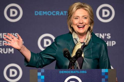 Democratic presidential candidate Hillary Rodham Clinton speaks to the Democratic National Committee 22nd Annual Women's Leadership Forum National Issues Conference in Washington, Friday, Oct. 23, 2015. (AP Photo/Jacquelyn Martin)