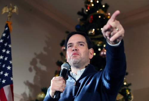 FILE - In this Monday, Dec. 21, 2015, file photo, Republican presidential candidate Sen. Marco Rubio, R-Fla., points to a potential supporter for a question during a campaign stop in Rochester, N.H. As 2015 wanes, the Florida senator is back in Iowa on Tuesday, Dec. 29, for a multi-day swing, hoping to shore up support and finish in the top tier of candidates in the Feb. 1 caucuses. (AP Photo/Mary Schwalm, File)