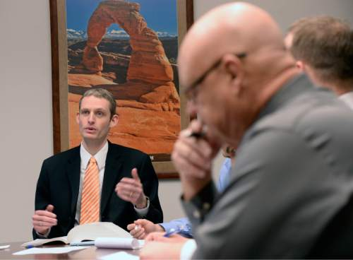 Al Hartmann  |  The Salt Lake Tribune Division of Consumer Protection Director Daniel O'Bannon leads a team meeting with investigators Thursday Jan. 14  in Salt Lake City.