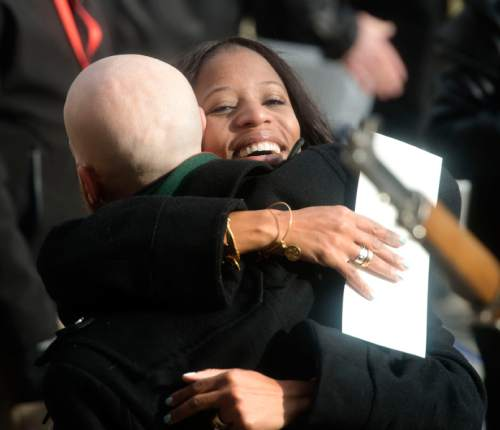 Steve Griffin  |  The Salt Lake Tribune  Rep. Mia Love hugs Salt Lake City Council member Derek Kitchen before the Oath of Office Ceremony for newly elected officials at the City & County Building in Salt Lake City, Monday, January 4, 2016.