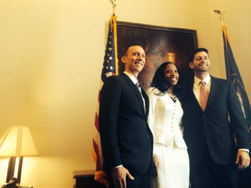 Thomas Burr  |  The Salt Lake Tribune Rep. Mia Love, R-Utah, center, poses for photos with her husband, Jason, left, and Rep. Paul Ryan, R-Wis., right, on Tuesday ahead of being sworn into Congress as Utah's newest member.